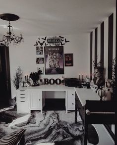 a black and white bedroom with scary busts, skulls, striped pumpkins, a watercolro rug and a Beetlejuice gallery wall bedroom Halloween 839076974309486786 Halloween Bedroom, Halloween Home Decor, Halloween Ideas, Halloween Living Room, Halloween House, Halloween Party, Dark Home Decor, Goth Home Decor, Creepy Home Decor