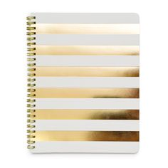 Buy cheap white notebook and buy gold paper from Joannes and bam! diy notebook. Can put golden dots instead