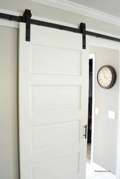 Repurposing an old door as a barn door