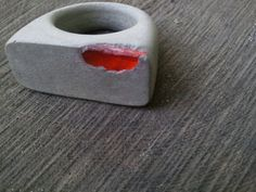 Concrete ring with exposed orange recycled glass.--Absolutely amazing piece!!