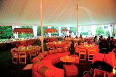 The rust and green tent decor provided by Elegant Affairs for mehdhi night or sangeet