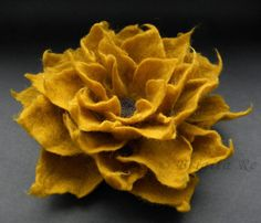 Inspiration: See what you can do when you felt an old woolen sweater? You can cut it up into petals and make a fabulous flower brooch!