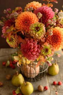 Autumn flowers  Arranged by Yuri Tanabe - I would swap out the pears for mini pumpkins, gourds and/or apples ... love the flowers!