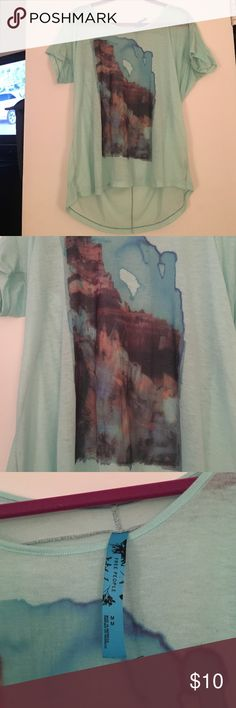 Free people turquoise tunic tee We the free turquoise long tee with graphic on front. Super comfortable - great with leggings! Free People Tops Tees - Short Sleeve