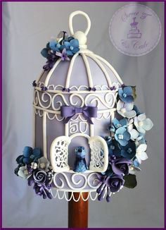 This is my first birdcage Cake. A special request from my mum who has just celebrated her 50th birthday. When mum asked if i would make her ...