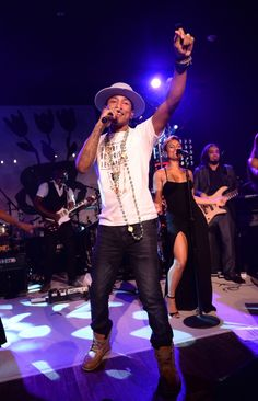 """Come Get It Bae."" Pharrell Williams beckons his audience during a performance at Apollo in the Hamptons: A Night of Legends on Aug. 16 in East Hampton, N.Y."