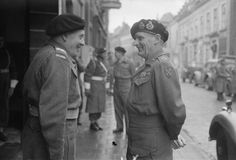 Field Marshal Bernard Montgomery in conversation with General Stanisław Maczek, the Commander of the 1st Polish Armoured Division, during his visit to the Division Headquarters in Breda, 25 November 1944. Marshal Montgomery decorated a number od Polish servicemen during his visit. Note a censor's marks obscuring the background.