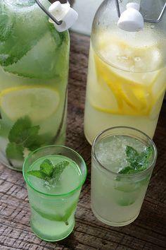 Homemade Herbal Lemonade                      1 plus 1/2 C. granular sugar 5 large sprigs of fresh mint 1 small bunch of citrus thyme or other herb 1 vanilla bean 6 ripe lemons water ice