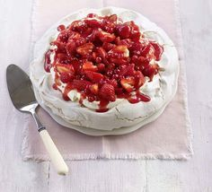 """Strawberry Pavlova from BBC Good Food: """"When you find a punnet of perfectly ripe strawberries, showcase them in this irresistible summer dessert"""" Bbc Good Food Recipes, Sweet Recipes, Cooking Recipes, Cooking Videos, Strawberry Pavlova, Strawberry Sauce, Mary Berry Pavlova, Strawberry Yum Yum Recipe, Bagels"""