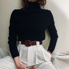 Black turtleneck and high-waisted white trousers.