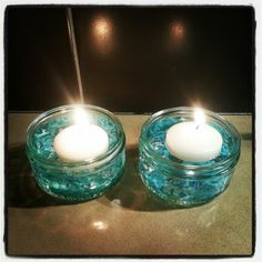 Made these tonight using GU dessert jars, clear acrylic rocks, turquoise craft stones and white floating candles. I now have six to group around the spa for ambiance