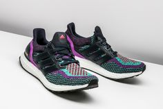 Vibrant hues of Night Navy and Shock Purple are woven throughout the Primeknit upper on this adidas Ultra Boost.