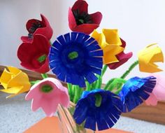 Egg Carton Flowers: These beautiful egg carton flowers are so easy to make, and a lovely homemade mothers day gift idea for your Mom!  What materials did you use?  ~ Paper