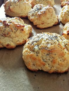 Toasted cardamom seed drop biscuits topped with poppy seeds and garlic butter await the sage sausage and gravy.