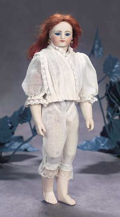 View Catalog Item - Theriault's Antique Doll Auctions - petite german bisque doll with twill body and bare feet by simo halbig, 10""