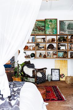 Bedroom shelves are chockablock with curated treasures, carefully layered to stunning effect.