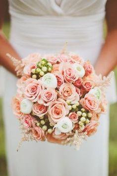 Apricot and blush.  Roses, astilbe and berries with touches of white ranunculus.