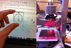 Raspberry Pi Laser Engraver Created Using Two Old DVD Drives (video)