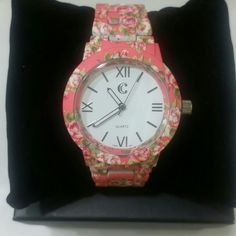 Pink floral watch Sooo cute! This is pretty much perfect year round and even more so for spring and summer.   This watch is in awesome condition. I don't wear my watches as often as I should, but when I am not wearing them I pull the crown out so the battery lasts longer.   Please let me know if you have any questions or would like additional pictures. Thank you!   Also, I am open to offers!! Charming Charlie Accessories Watches
