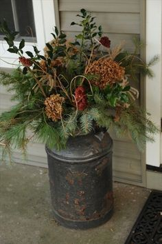 Late fall early winter front porch decor. Another great milk can idea!! for Kaye????