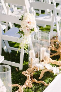 Floral Aisle Markers + Candle Décor   Photo: Brian Leahy Photography. View More:  http://www.insideweddings.com/weddings/beachy-southern-california-ceremony-winter-wonderland-reception/877/