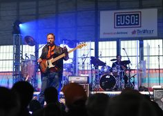 Actor/Musician Gary Sinise performs for troops and military families at U.S. Coast Guard Base Kodiak. (U.S. Coast Guard photo by Petty Officer 1st Class Sara Francis.)