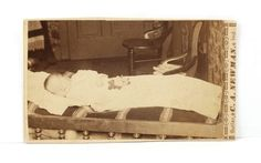 Post-Mortem-of-Baby-Laid-out-in-Crib-bed-CDV-by-C-A-NEWMAN-of-BUTLER-IND