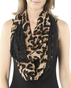 This chic everyday eternity scarf features a woven body  with a leopard print and contrasting delicate leopard pattern lace. Twist it into an 8 or wear like a cozy necklace.      Polyester     Imported
