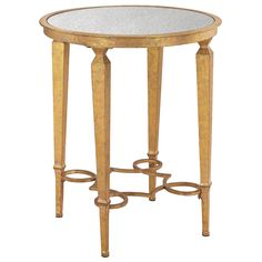 "The Charlotte accent table creates a polished presence in a sophisticated living space or bedroom. A traditional round silhouette gains interest from an antiqued mirror top and elaborately curved stretcher. Tapered legs complete the glamorous look in a gleaming gold finish. 21""W x 21""D x 26""H. Metal, antiqued mirror. Antiqued gold finish."