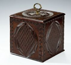 Rare Dutch tea caddy. A rare Dutch tea caddy in mahogany with chip carved geometric decoration on all sides and top, with its original axe-mead handle and original patina.