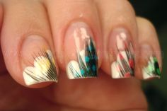 I saw something similar on tv a few days ago but I like this variation of feather nails better. For the basic style, you'll need scissors, feathers, and clear polish. Start with a clear coat, while it's still wet put the end of a feather over it, and paint another coat. Once the polish is dry, trip the feather to the length of your nail and you're all set!