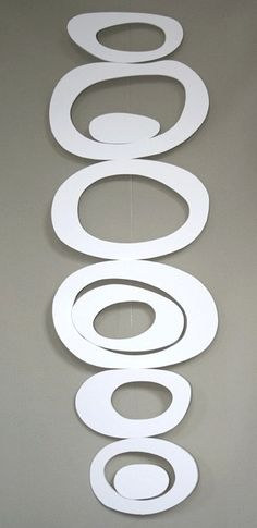 Alexander Calder-like...this is made with foam core board into a mobile.  I like the simplicity...could use metal and form or cut links to form a necklace or bracelet... -repinned from http://LinusGallery.com #art #artists