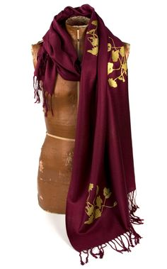 """Stay warm and wrap up in Norwich's colors this winter!   Large maroon Pashmina scarf. """"Poppy"""" design. Silkscreened with metallic gold ink."""
