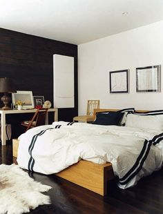 dark wall, striped duvet, fur rug and wood floors #home #homedecor #bedroom #interiordesign