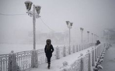 Breathtaking Photos of the Coldest City in the World - A woman walks over an ice-encrusted bridge in Yakutsk. Oymyakon lies a two day drive from the city of Yakutsk, the regional capital. Coldest City On Earth, Earth Weather, Uk Weather, Weather Forecast, Extreme Weather, Ukraine, Outside Toilet, Visit Russia, Destinations
