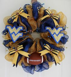 Best Of AmericanTowns delivers the most interesting and unique places in America right to your fingertips. Browse the best places to eat, live, and visit. Wvu Football, Football Wreath, Wvu Sports, Sports Wreaths, West Virginia University, Sport Craft, Pallet Painting, Deco Mesh Wreaths, 4th Of July Wreath