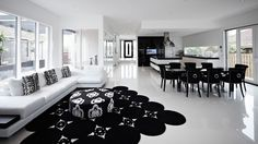 Shared living & dining area reflecting black & white combination by Melbourne Custom Home builder Bellemore homes Custom Home Builders, Custom Homes, Luxury Homes Interior, White Houses, Dining Area, House Design, Black And White, Living Room, Table