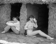 """Mel Ferrer photographed with his wifeAudrey Hepburn by Milton H. Greene at""""La Vigna"""" (a charming villa outside Rome) especially for Look magazine, 1955."""