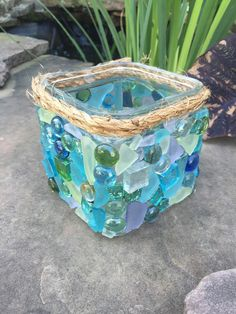 This stunning piece was made using a variety of sea glass, mosaic tiles, and glass beads.  What a perfect touch to any beachy or nautical space.