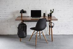 """""""We love their minimalist designs, but their desks also pack in lots of possibilities to create the optimal workspace. There's a built-in dock that not only manages unruly power cords, it keeps your devices propped up in place."""""""