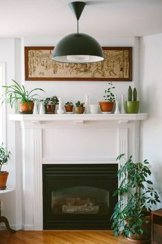 simple plants and vases on white mantel above fireplace. White Mantel, White Fireplace, Fireplace Mantle, Fireplace Decorations, Above Fireplace Decor, Tiled Fireplace, Fireplace Ideas, Home Living Room, Living Room Decor