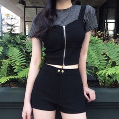 Corset top over stripes, black shorts