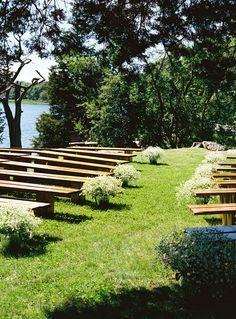 Ceremony Aisle Decor | Bucket of Baby's Breath -- so Serene | Rustic Elegance on #SMP Weddings: http://www.stylemepretty.com/2013/12/13/bristol-rhode-island-wedding  Charlotte Jenks Lewis Photography
