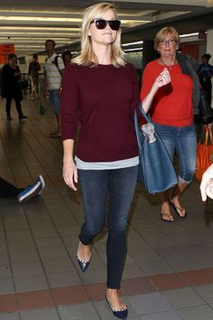 Reese keeps it clean and chic in a berry knit and skinny jeans as she heads out of LAX – and don't miss those studded ballerinas.