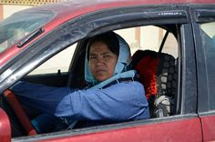 First woman taxi driver of Afghanistan Sara Bahai works for the women who aren't allowed to use taxis without their first degree men relatives. Balkh, Afghanistan, (Photo by Sayed Khodaberdi Sadat/Anadolu Agency/Getty Images)