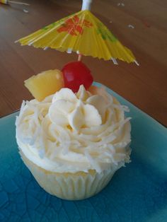 coconut cupcakes with pina colada frosting