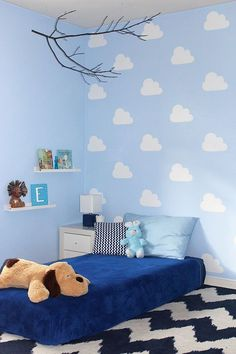 DIY cloud stencil for kid's bedroom. Stencil painted accent wall with clouds.