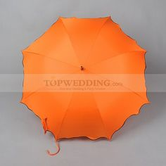 Bright and warm, this umbrella is colored in orange which is perfect for autumn.