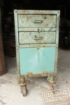 Vintage Industrial Cart in a gorgeous and original Teal color!  Check out those castors.