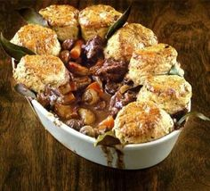 Herby Lamb Cobbler With Sunflower Oil Smoked Streaky Bacon Lamb Neck Fillets Onion Carrots Button Mushroom Plain Flour Bay Leaf Thyme Red Wine Lamb Stock Worcestershire Sauce Self Raising Flour Herb Butter Lemon Fruits Bay Leaf Beaten Egg Lamb Recipes, Dinner Recipes, Savoury Recipes, Lamb Neck Fillet Recipes, Lamb Casserole Recipes, Duck Recipes, Bbc Good Food Recipes, Cooking Recipes, Cooking Tips